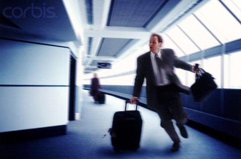 Businessman Running to Catch a Flight
